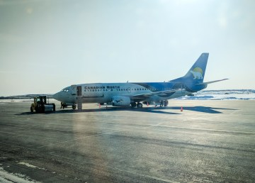 A Canadian North aircraft waits at Inuvik's Mike Zubko Airport in April 2018