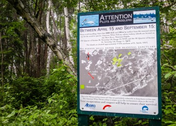 A sign near the Slave River warns people to respect a 100m exclusion zone surrounding a protected pelican nesting site