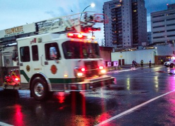 Municipal enforcement officers and firefighters at work in downtown Yellowknife as a fire truck arrives