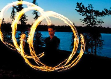 Viva Savage is pictured in the middle of a fire spinning routine
