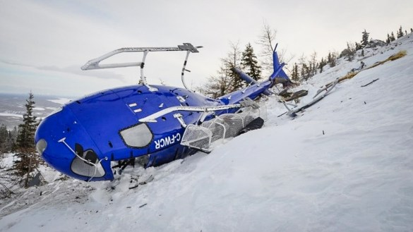 A photograph provided to the Transportation Safety Board of Canada by Great Slave Helicopters shows a downed helicopter in February 2018