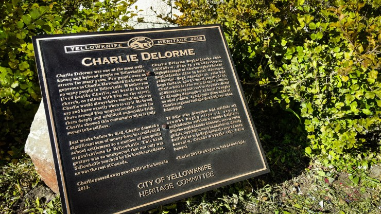 A plaque dedicated to Charlie Delorme on Yellowknife's 48 Street