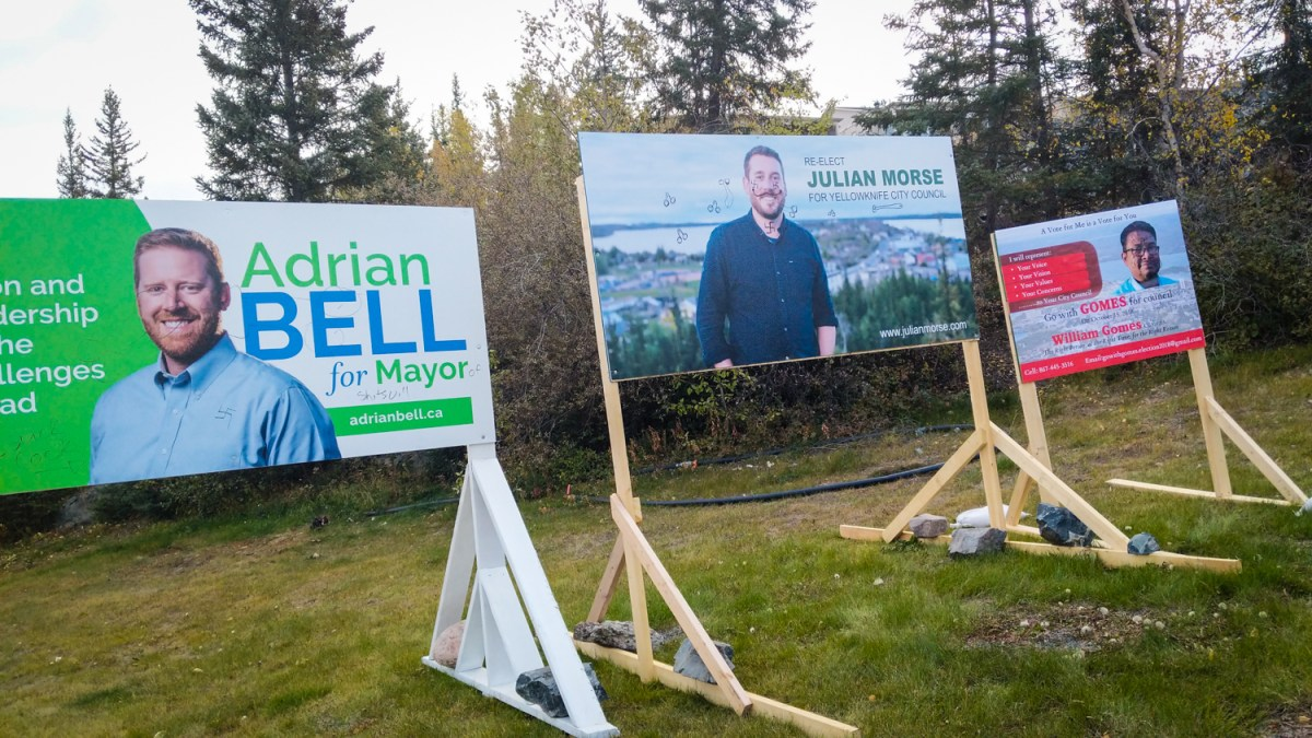 Candidates clean up each others' vandalized signs – again