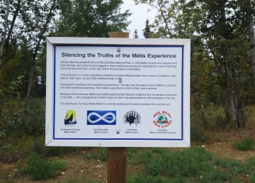 A file photo of a sign South Slave Métis groups put up in Fort Smith protesting Métis expulsion from Wood Buffalo National Park. Sarah Pruys/Cabin Radio
