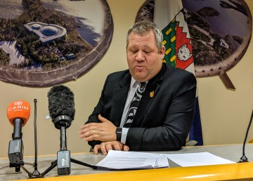 Glen Abernethy, the health and social services minister, is pictured at a government briefing in 2018