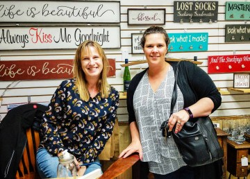 Kerri Nolting, left, with her first customer after opening The Farmhouse inside Yellowknife's YK Centre mall