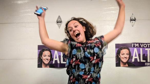 Rebecca Alty jumps for joy at her campaign party shortly after discovering she will be Yellowknife's next mayor