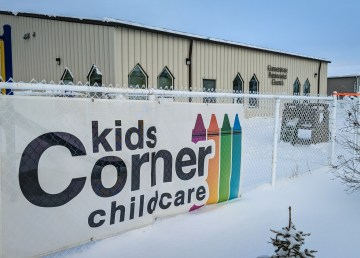A banner for Kids Corner childcare outside the premises of the Cornerstone Pentecostal Church in November 2018