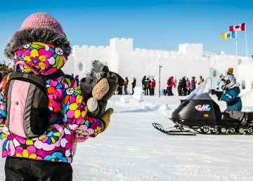 A young visitor to Yellowknife's Snowcastle - Tawna Brown-NWT Tourism