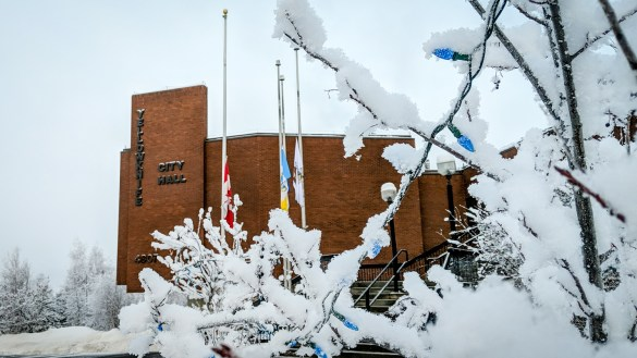 Flags at City Hall in Yellowknife are seen at half-mast on December 5, 2018