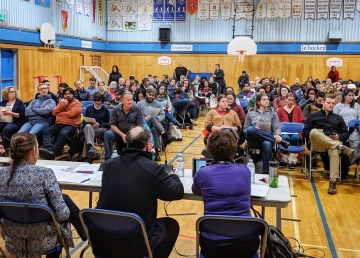 Parents sit before a panel discussing the construction of a new JH Sissons School on January 10, 2019