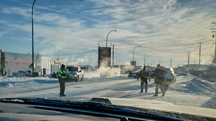 Police officers are seen on Old Airport Road on January 28, 2019