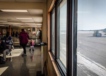 Passengers wait at Inuvik Mike Zubko Airport in an April 2018 file photo