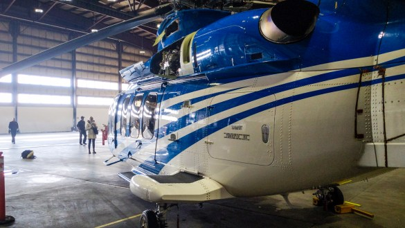 A Bell 525 Relentless helicopter sits inside the First Air hangar at Yellowknife Airport