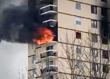 A fire burns inside Hay River's highrise on the afternoon of March 15, 2019