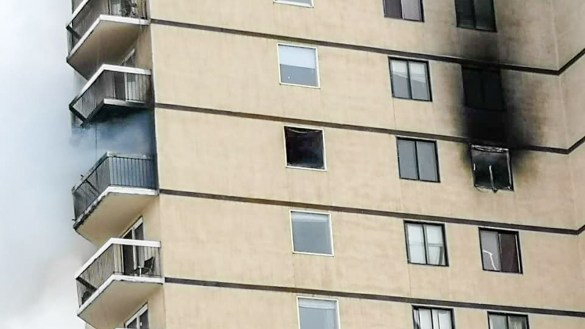A fire dies down inside Hay River's highrise on March 15, 2019