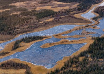 An aerial view of a small lake in the South Slave region of the Northwest Territories in October 2018. Sarah Pruys/Cabin Radio