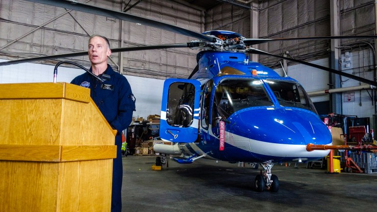 Pat Lindauer speaks in front of a prototype Bell 525 Relentless helicopter at the First Air hangar in Yellowknife