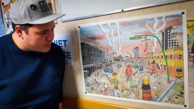 Cabin Radio's Jesse Wheeler studies a Walt Humphries print in Studio One