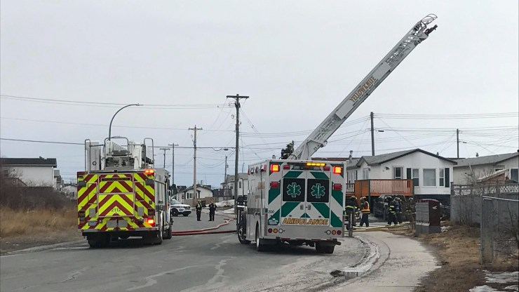 Fire crews respond to a fire in Yellowknife's Kam Lake district on April 23, 2019