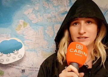 Sara Wicks in front of the Cabin Radio Weather Map