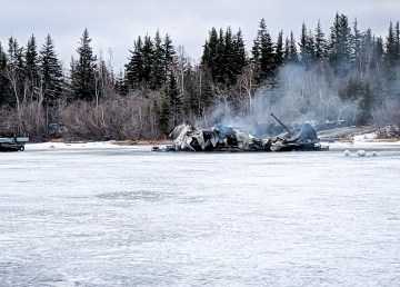 The remains of a houseboat which caught fire on Yellowknife Bay in the early hours of May 15, 2019