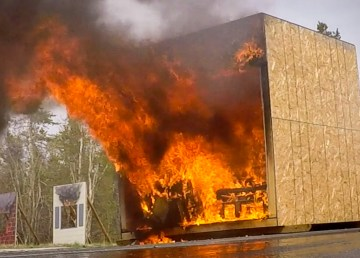 A fire inside a mock bedroom at Yellowknife's fire hall in June 2019