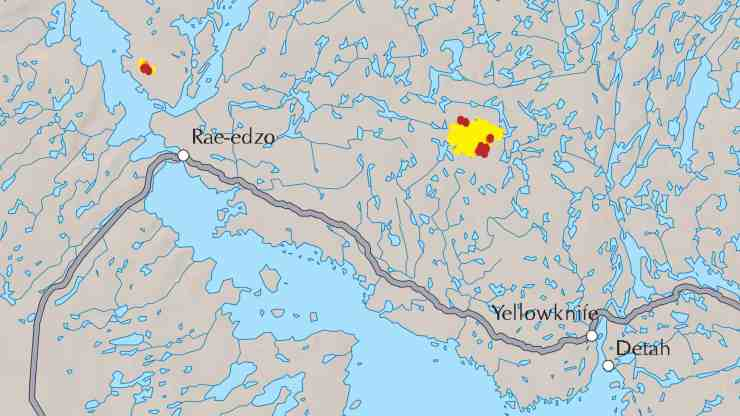 A map shows recent hotspots (in red) and overall extent (in yellow) of wildfires outside Behchoko and Yellowknife as of July 24, 2019