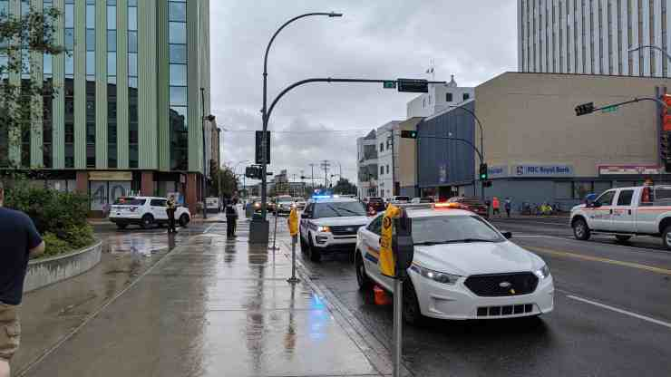 Police vehicles outside the Northwestel building on July 30, 2019