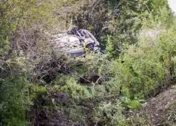 A vehicle lies upended in scrubland in Yellowknife's Kam Lake area on August 7, 2019