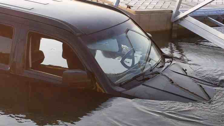 The front of a partly submerged vehicle