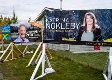 Candidates' election signs outside Sir John Franklin High School in Yellowknife on September 6, 2019