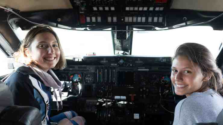 Students Isabelle Boucher and Amelie Wood inside the cockpit of the Nasa jet