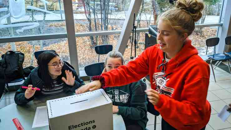 A St Pat's high school student casts a vote in a mock federal election on October 18, 2019