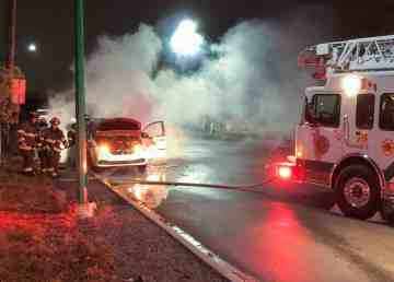 A submitted image of a City Cab vehicle on fire on Yellowknife's Con Road