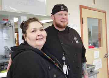 President Casey Adlem, left, and chef Ethan Mackenzie at Larga Kitikmeot's kitchen