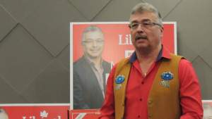 Michael McLeod speaks after his campaign declares victory
