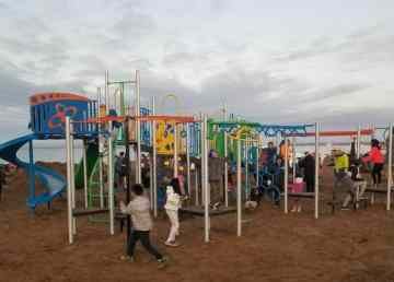 Children played late into the night as a new playground opened in Paulatuk