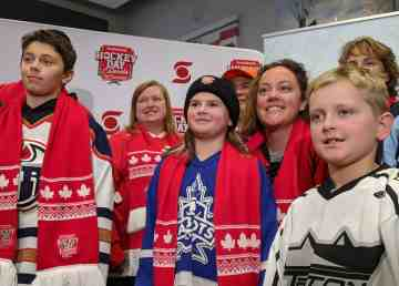 Mayor Rebecca Alty and dignitaries pose with children at a Hockey Day in Canada news conference