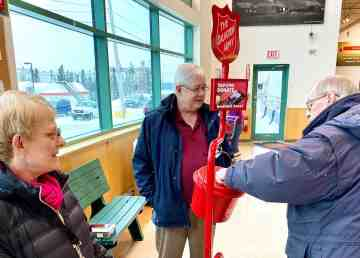 Rotary Club of Yellowknife member Brian George, and Debra George, volunteer at a kettle at the Yellowknife Co-op