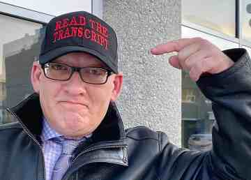 Former Norman Wells mayor Nathan Watson points to his Read the Transcript hat – adding he was channelling US President Donald Trump – outside the Yellowknife Courthouse during a break in proceedings on Wednesday