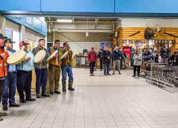 Dene drummers welcome passengers from Vancouver arriving at Yellowknife Airport