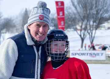 Ron McLean with a young player at Hockey Day in Canada 2019, held in Swift Current, Saskatchewan