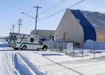 An ambulance waits outside a hangar near Yellowknife Airport on February 18, 2020