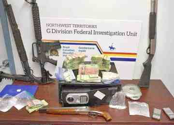 An RCMP handout image shows cocaine, a safe, firearms, and cash after raids on two locations in Yellowknife in Sept. 8, 2017