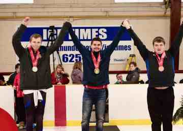 Josh Boudreau, centre, on the podium at the Special Olympics Canada Winter Games in Thunder Bay