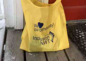 An Inclusion NWT package waits on a Yellowknife doorstep