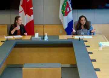 Premier Caroline Cochrane, left, and Dr Kami Kandola prepare for a news conference by video link on April 4, 2020