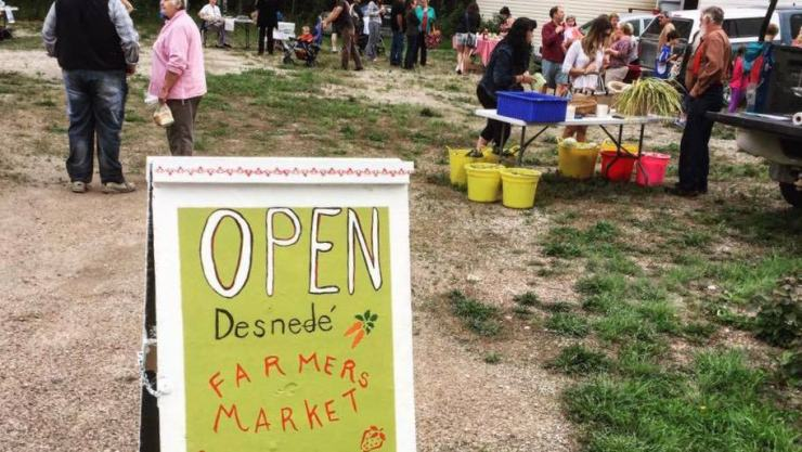 A sign welcomes visitors to the Desnedé Farmers' Market in an image posted to Facebook by the market's organizers