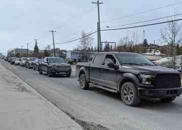 Trucks parade in memory of Les Rocher on May 3, 2020